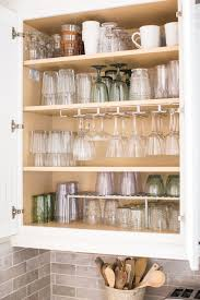 how do you arrange dishes in kitchen cabinets how to organize your glassware cabinet once and for all