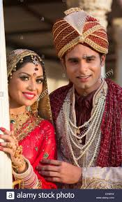 traditional dress up of indian weddings indian and groom in traditional wedding dress stock photo