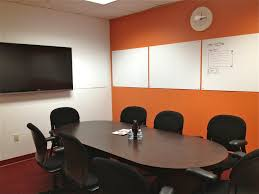 imple meeting room with rectangular white stained wooden