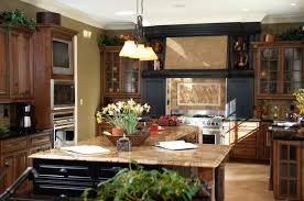52 dark kitchens with dark wood and black kitchen cabinets home black wood cabinetry surrounds range with beige tile backsplash in this detailed kitchen l