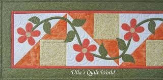 ulla s quilt world table runner quilt with flowers
