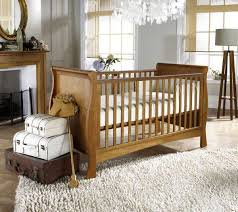 bedroom country room with baby room inside has wooden crib with