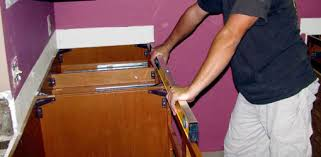 installing granite countertops on existing cabinets how to install a granite tile countertop today s homeowner