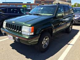 wrecked black jeep grand cherokee curbside classic 1995 jeep grand cherokee orvis edition