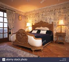 Spanish Bedroom Furniture by Ornate Carved Wooden Bed In Spanish Bedroom With Print Room