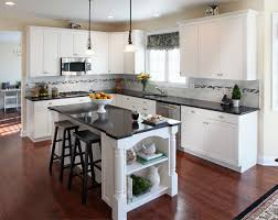 country style kitchen with white kitchen cabinets and black