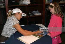natalie gulbis 2005 swimsuit calendar signing photos and images