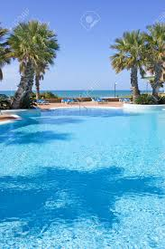 beautiful blue swimming pool in spanish hotel with ocean views