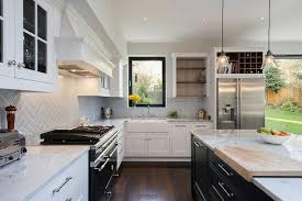 cookbook shelf and wine rack over fridge transitional kitchen
