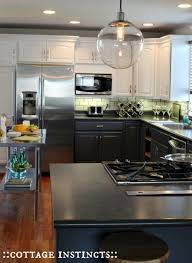 two tone kitchen cabinets with black countertops two tone kitchen cabinets to inspire your next redesign