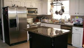white kitchen with black island kitchen kitchen with white cabinets and black island breakfast bar
