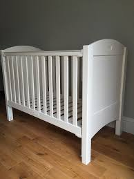white cot from feather and black with john lewis mattress and