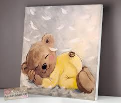 tableau pour chambre bébé tableau ourson endormi sur des plumes vente tableau ourson doux