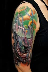 devil cheshire cat tattoo on right half sleeve by fernando puedmag