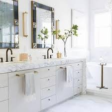 white and black bathroom with brass accents transitional bathroom