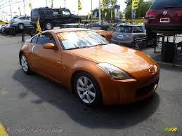 orange nissan 350z 2003 nissan 350z touring coupe in le mans sunset 017273 autos