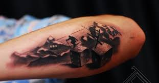 skiers in mountains and devils bones forearm tattoos book