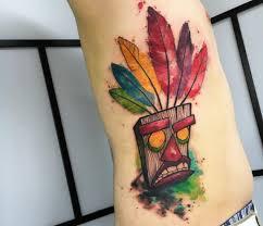 watercolor tiki mask tattoo by emrah de lausbub inked