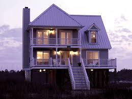 Coastal Cottage Plans by Parham Raised Coastal Home Vacation Style Porch And Plan Front