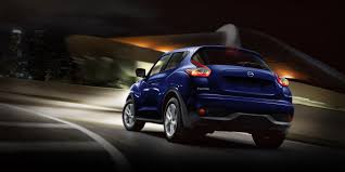 nissan convertible juke 2015 nissan juke shown in cosmic blue rear view driving at night