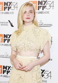 elle fanning delights in pale yellow dress at 20th century women