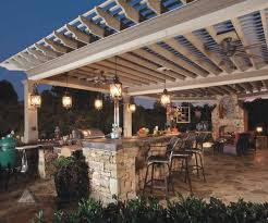 artistic lighting ideas for outdoor kitchens using wrought iron
