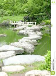 stone bridge and water pond in japanese zen garden stock photo