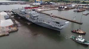 hms queen elizabeth leaves rosyth dockyard as largest warship in
