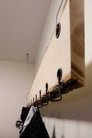 wood racks and wall shelves with bark trim organic design ideas