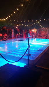 custom built dance floor over swimming pool with lights dpc