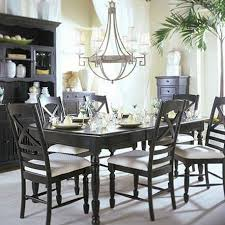 rustic dining area with chandelier black cabinet black table with