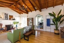 pleasant little spanish style in palms asks 1 05m curbed la the living room has hardwood floors built in shelving and a tile fireplace photos courtesy compass realty