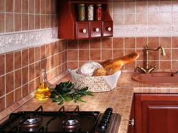 brown tile countertop and backsplash olive oil black gas range