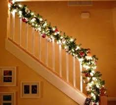 stairway banister decorated for light garland