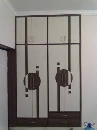 Latest Bedroom Door Designs by Modern Wardrobe Design In Brown With Mirror Sliding Door And