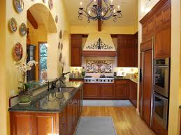 kitchen style galley kitchen design showing brown cabinets and