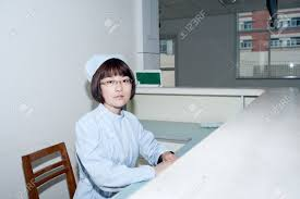 Hospital Reception Desk Nurse Standing Hospital Reception Desk Stock Photo Picture And