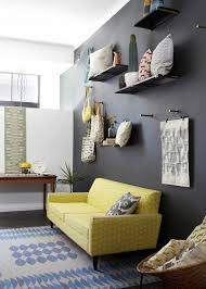 living room yello and grey sofa with black wall colors stunning