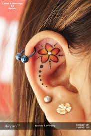 ear tattoo with piercing pictures to pin on pinterest tattooskid