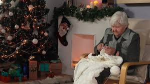what to get an elderly woman for christmas an elderly woman knits a blanket sitting in a chair next to the