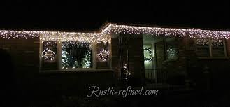 best christmas lights for house how to hang christmas lights the easy way rustic refined
