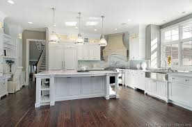 Transitional White Kitchen - corner stove transitional kitchen kitchen design ideas