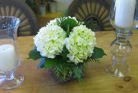 White Hydrangea Centerpiece by White Hydrangea Centerpiece Hydrangea With Greens On Table