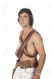pistolero with ammunition belts across his chest stock photo