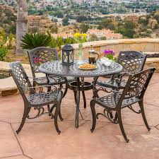 outdoor dining room furniture covington cast aluminum 5 piece outdoor dining set with round