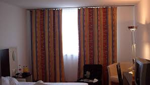 How To Hang Pictures On A Wall How To Hang Drapes When The Window Meets The Wall Homesteady