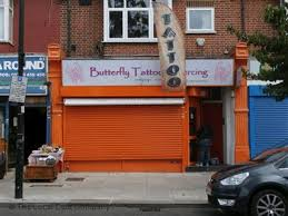 butterfly and piercing on greenford avenue tattooing