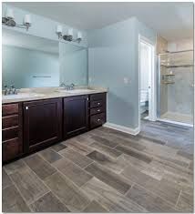 master bathroom with custom tiled shower and wood look gray tiles