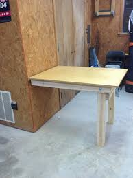 diy fold down workbench wilker do s this would be a great bench for anywhere you need to have a temporary workspace but don t have the room to give it up permanently such as a garage where