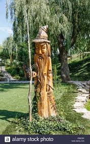 canadian chainsaw art carvings from dead trees as backyard decor